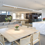 View of the kitchen area which features an countertop, interior design, kitchen, real estate, table, gray
