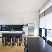 View of a minimal kitchen area which was architecture, floor, house, interior design, kitchen, living room, loft, real estate, white