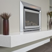 View of a fireplace with a marble hearth fireplace, furniture, hearth, product design, gray