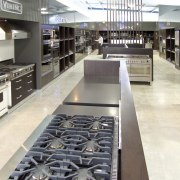 View of a Kitchen Things showroom which features countertop, floor, flooring, kitchen, white, gray