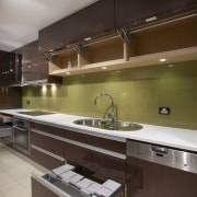 View of an Apollo Kitchens showroom which showcases cabinetry, countertop, interior design, kitchen, brown, gray