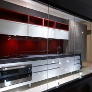 View of an Apollo Kitchens showroom which showcases cabinetry, countertop, interior design, kitchen, black