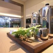 View of open-plan kitchen area featuring island woodgrain interior design, orange, brown