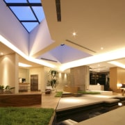 View of open-plan living area featuring indoor water apartment, architecture, ceiling, condominium, daylighting, estate, home, house, interior design, lighting, lobby, property, real estate, residential area, roof, window, brown, orange