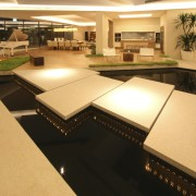 View of open-plan living area featuring indoor water billiard room, floor, flooring, furniture, interior design, recreation room, table, orange