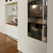 View of a kitchen which features St George cabinetry, countertop, display case, furniture, home appliance, kitchen, kitchen appliance, gray, brown