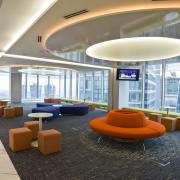View of the staff recreation room which features architecture, ceiling, daylighting, interior design, lobby, real estate, white