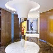 View of a sculpture in the corridor with ceiling, floor, flooring, interior design, lobby, real estate, table, white, brown