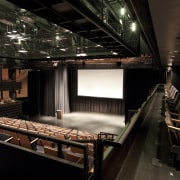 Interior view of the theatre with cascading seating, interior design, performing arts center, theatre, black