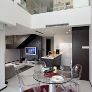 Interior view of open-plan apartment living area with ceiling, countertop, interior design, kitchen, living room, gray