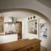 View of a kitchen which features St George architecture, cabinetry, ceiling, countertop, cuisine classique, home, house, interior design, kitchen, room, wood, brown, gray
