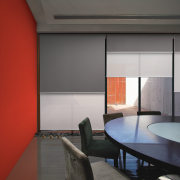 Interior view of an office area which features architecture, ceiling, daylighting, house, interior design, shade, table, window, window covering, gray, red