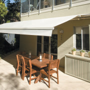 View of an outdoor area which features a awning, canopy, patio, real estate, shade, table, white, brown