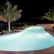 View of a resort-styled pool which was built arecales, estate, leisure, lighting, palm tree, property, real estate, resort, swimming pool, water, black