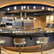 View of a kitchen which features a U-shaped countertop, interior design, kitchen, brown