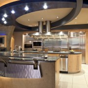 View of a kitchen which features a U-shaped ceiling, countertop, interior design, kitchen, lobby, orange, brown
