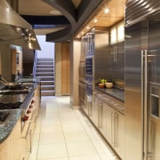 View of a kitchen which features a granite ceiling, countertop, interior design, kitchen, brown