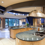 View of a kitchen which features a U-shaped countertop, estate, interior design, kitchen, real estate, orange, brown