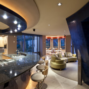 View of a kitchen which features a U-shaped apartment, architecture, ceiling, home, interior design, lighting, living room, real estate, room, brown