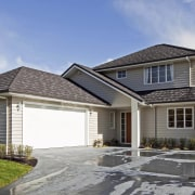 Exterior view of a Landmark Homes show home building, cottage, elevation, estate, facade, farmhouse, home, house, property, real estate, residential area, roof, siding, window, gray