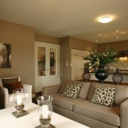 View of main living area of this Landmark ceiling, home, interior design, living room, real estate, room, wall, brown