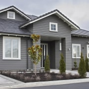 Exterior view of a Landmark Homes show home building, cottage, elevation, facade, home, house, neighbourhood, property, real estate, residential area, siding, suburb, window, gray