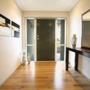 interior view of front entrance of this Platinum floor, flooring, interior design, real estate, room, white, orange