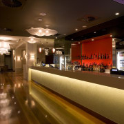 View of contemporary bar which features a CaesarStone bar, interior design, restaurant, brown