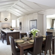 View of kitchen and dining area featuring floor-to-ceiling ceiling, dining room, interior design, kitchen, property, real estate, room, gray, white