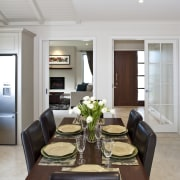 View of dining area featuring dining suite, tiled ceiling, dining room, interior design, living room, room, table, gray