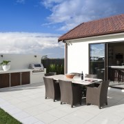View of the outdoor living area featuring tiled backyard, home, house, outdoor structure, property, real estate, white