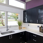 View of a remodeled kitchen which features lavender architecture, bathroom, cabinetry, countertop, home, interior design, kitchen, room, sink, window, gray, black