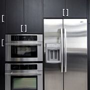 View of a remodeled kitchen which features dark home appliance, kitchen, kitchen appliance, major appliance, product, refrigerator, black, gray