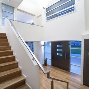 interior stairs view of a new home in architecture, daylighting, floor, handrail, interior design, real estate, stairs, white