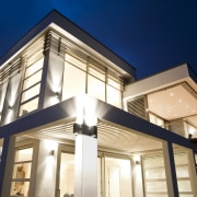 Exterior view of a new home in albany.PTG architecture, building, facade, home, house, lighting, property, real estate, sky, window, blue