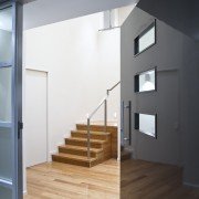 interior doorway view of a new home in architecture, door, floor, house, interior design, loft, stairs, wall, window, white