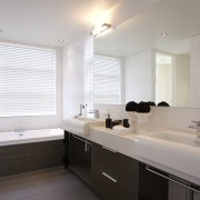 interior bathroom view of oak manor. Design by bathroom, home, interior design, real estate, room, sink, window, gray