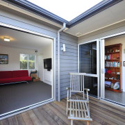 Exterior view of the deck area at this door, home, house, interior design, property, real estate, window, gray