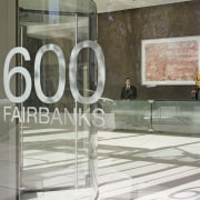 View of the entrance of 600 New Fairbanks floor, flooring, furniture, glass, interior design, table, gray, white