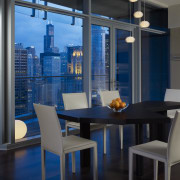 View of the Chicago skyline from the condominium. apartment, architecture, chair, dining room, furniture, interior design, table, window, black, blue