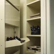 View of storage space in the condominium. - closet, furniture, interior design, product design, room, shelf, shelving, brown, yellow