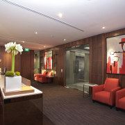 View of updated offices featuring dark timber floors, ceiling, interior design, lobby, real estate, room, red