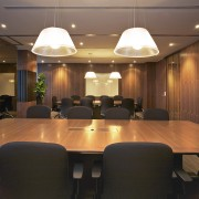 View of updated offices featuring dark timber floors, ceiling, conference hall, dining room, function hall, interior design, light fixture, lighting, room, table, black, brown