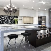 This kitchen by Yellowfox features an island with countertop, interior design, kitchen, gray