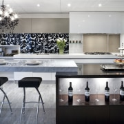 This kitchen by Yellowfox features an island with countertop, interior design, kitchen, product design, gray