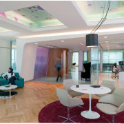 The new Zain headquarters in Bahrain reflects the ceiling, interior design, lobby, real estate, gray