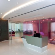 The new Zain headquarters in Bahrain reflects the ceiling, glass, interior design, lobby, gray