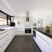 With a fully integrated kitchen design, appliances are countertop, interior design, kitchen, real estate, white