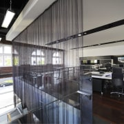 Architectural firm Coz Howlett & Bailey Woodland relocated interior design, black, gray