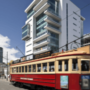 View of the Club Tower offices in Christchurch, architecture, building, cable car, condominium, downtown, facade, metropolis, metropolitan area, mixed use, neighbourhood, public transport, residential area, rolling stock, tram, transport, urban area, gray